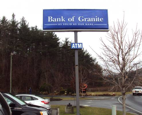 pylon sign at bank of granite